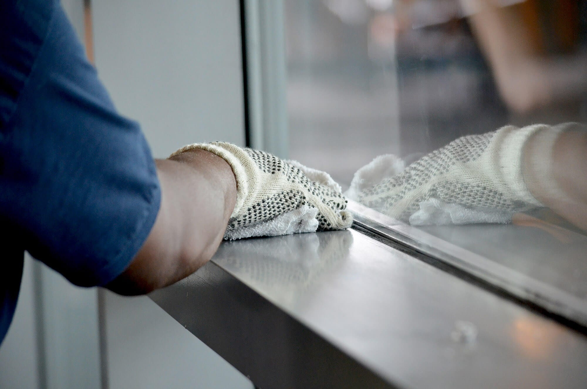 David cleans the window sill at the Staten Island Ferry Terminal