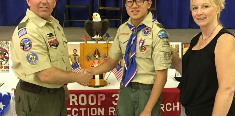 Scoutmaster Vincent Cirino, Eagle Scout David Kim, and Zoe Ann Deeds, Principal, Brooklyn Blue Feather