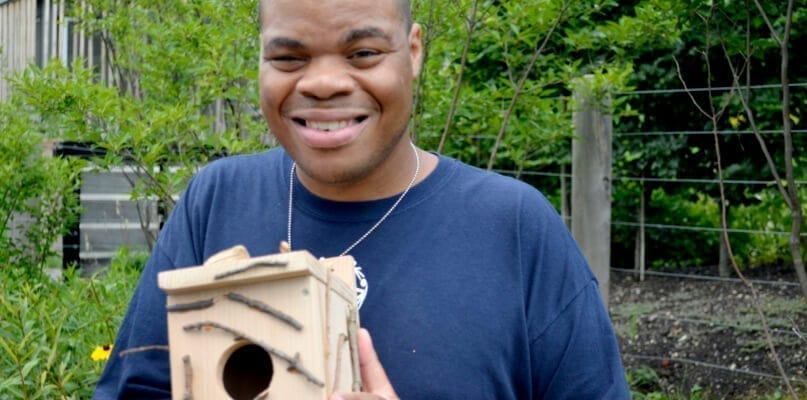 Kendrick Holley shows off his birdhouse.
