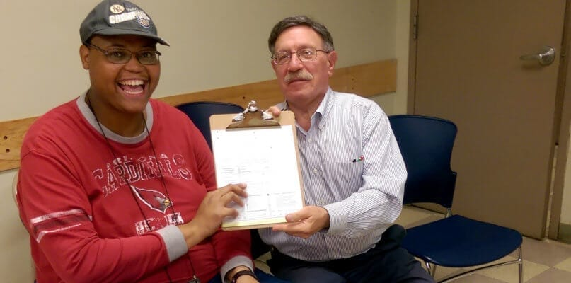 Jeffrey Holloway registers to vote with assistance from an official from the Board of Elections