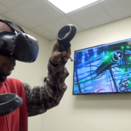 A screen in the VR room shows a portion of Cory's 3D environment