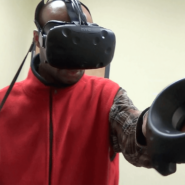 Cory demonstrates the use of the virtual reality gear.