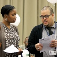 Recruitment Assistant, Oscar Bustamante provides a job seeker with information about AHRC NYC employment opportunities