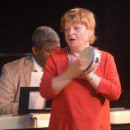 Danuta Chmielewski accompanies singing with the tambourine