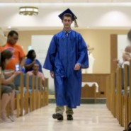 Marty Meyers proceeeds down the aisle during during the graduation ceremony