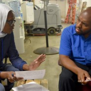 Hindou Kane and David Jackson discuss the day's work schedule