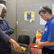 Hindou Kane with Hudson River Services worker, Joseph Giunta