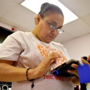 Ivelisse Cruz uses her AAC device to communicate to the group at AHRC NYC's Betty Pendler New York League