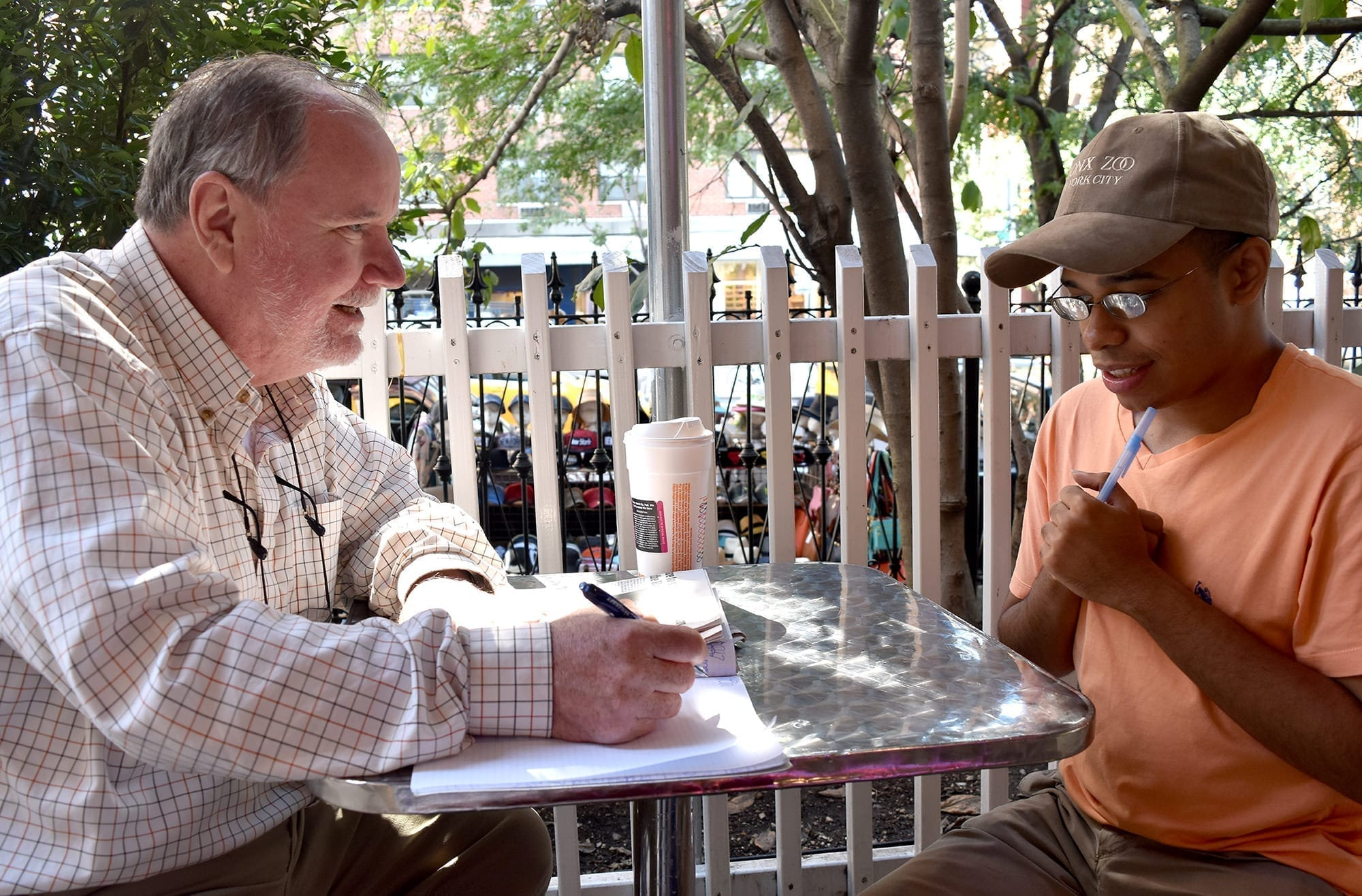 Peter Doherty prepares questions for Brandon McElroy, about the day's reading selection