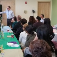 Marco discusses new AHRC NYC Initiates with staff at the Dorothy and Michael Styler Center
