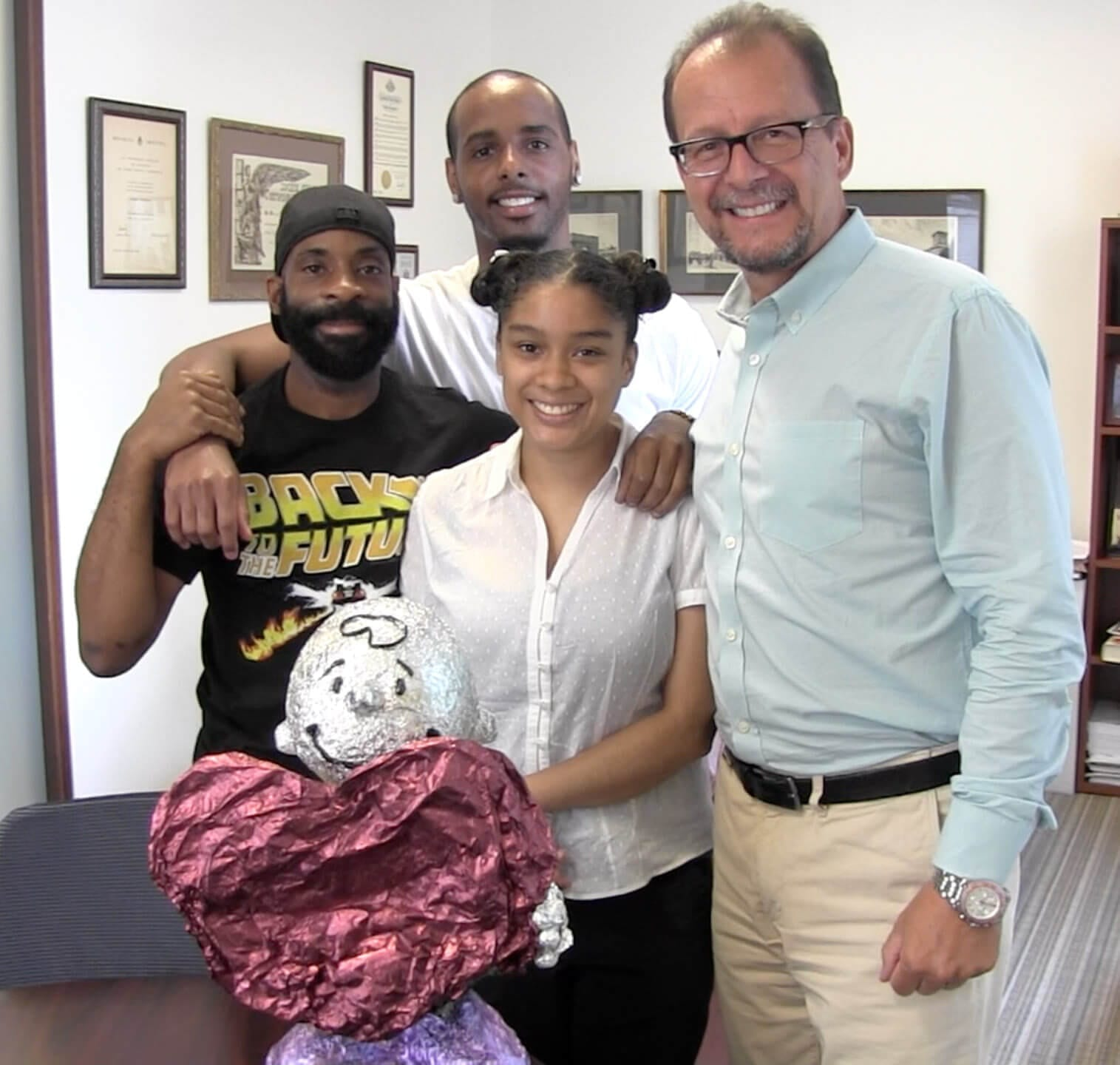 Art Consultant Dean Millien with CSP, Damian Gray and artist, Karaibe Hebbert
