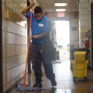 Lanora Woody cleans the hallway of Staten Island's Eltingville Transit Center