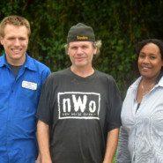 Zachary Gibbons, Dustin McNeely, and Crucelina Motta LaSalle outside the Eltingville Transit Center