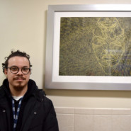 Carlos Wilfredo, Art Consultant, with his piece Untitled Self Portrait (2)