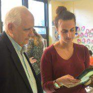 A teacher shows Assemblemember Joseph Lentol how educators use iPads in the school