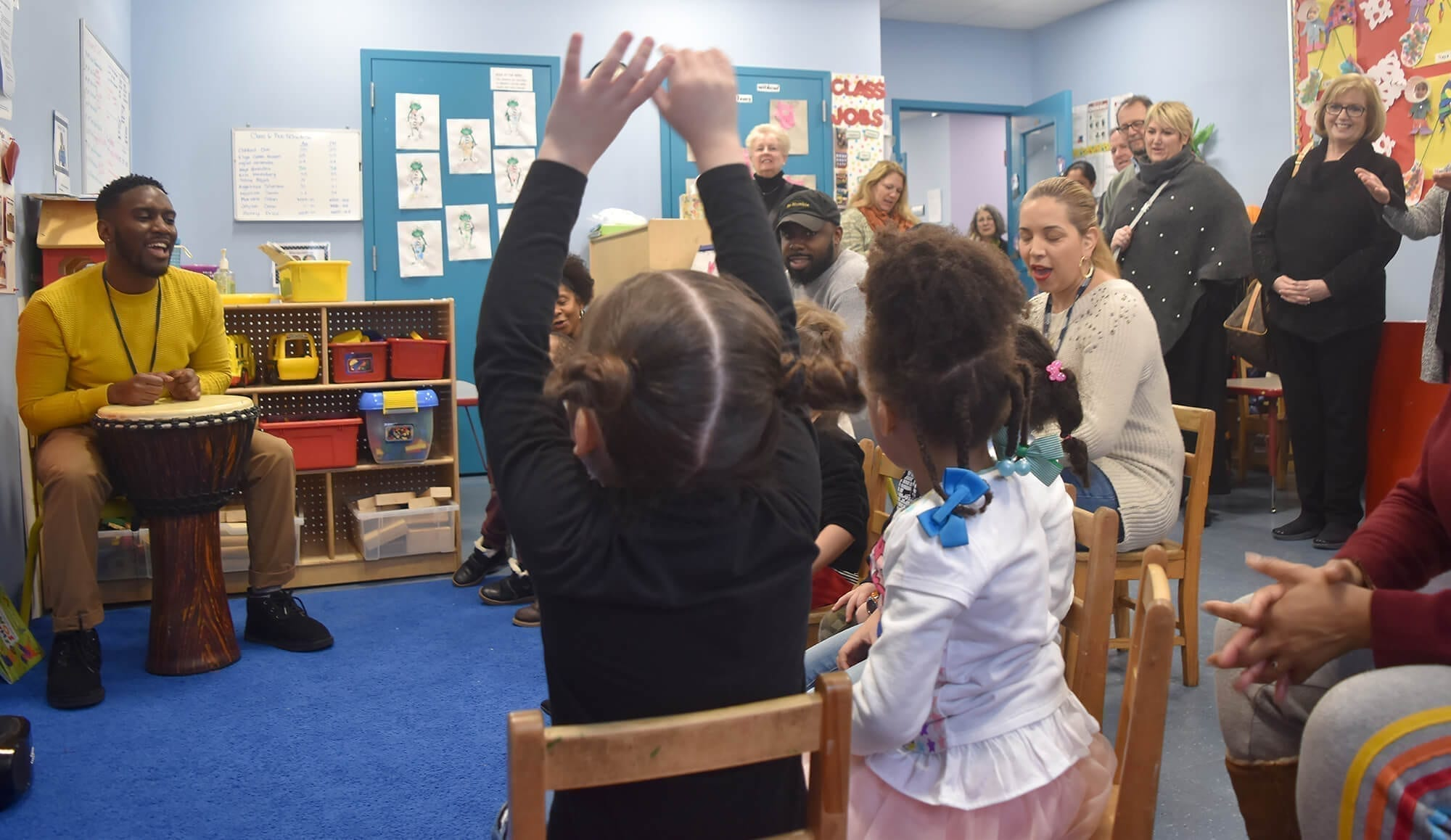 Children engage in a music therapy session at Esther Ashkenas Central Park Early Learning Center