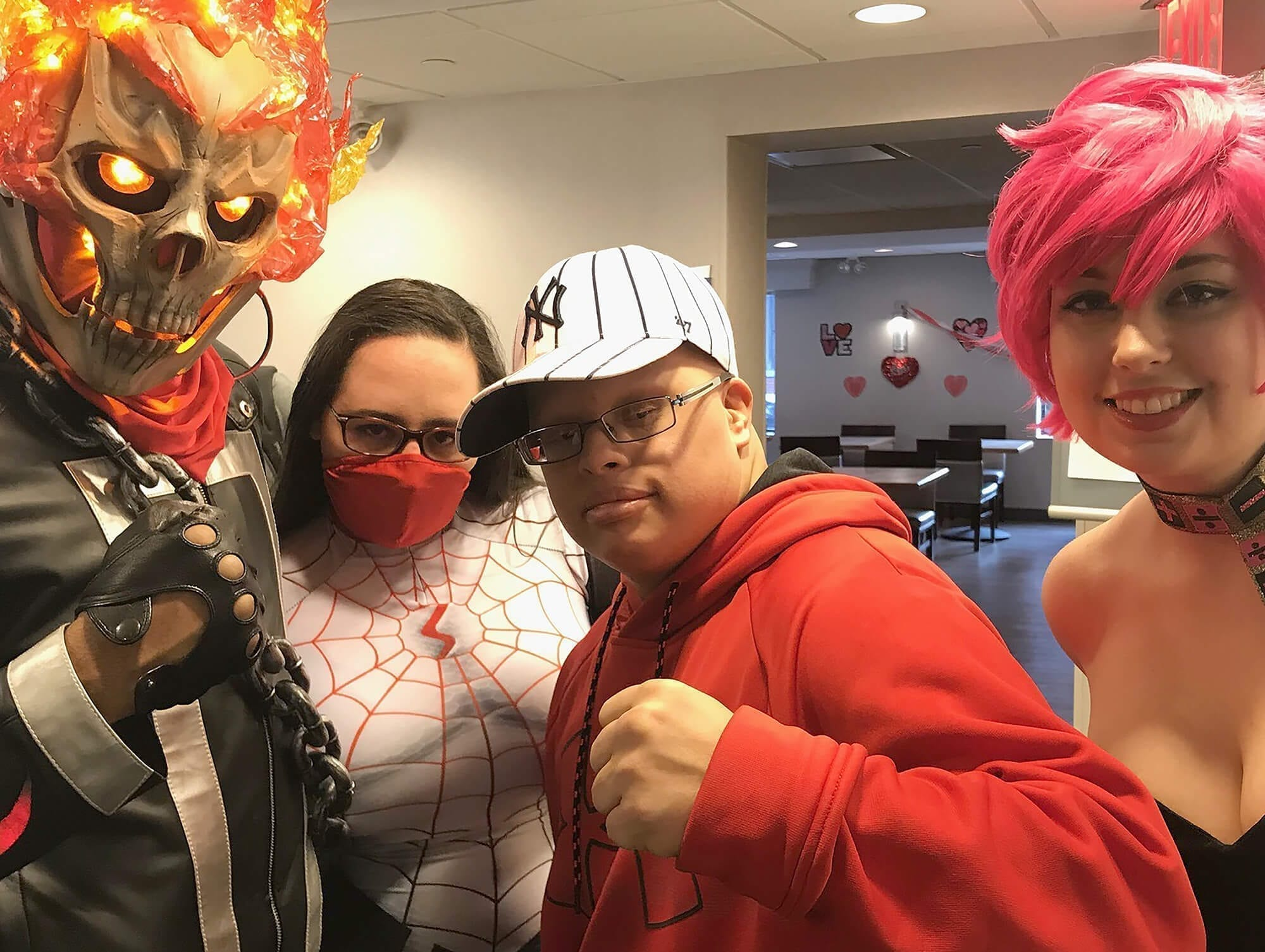 Alex Torres with a group of cosplayers at PowCon