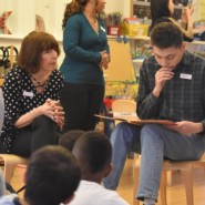Karen Zuckerman, Director Volunteer Services and Corporate Engagement, listened to Jerome as he read the book