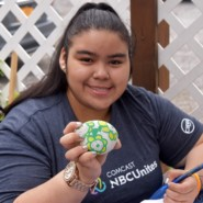 Erica Rojas painted a stone that can be used to beautify the Cyril Weinberg garden. Erica attends a Satruday program for teens at the day center.