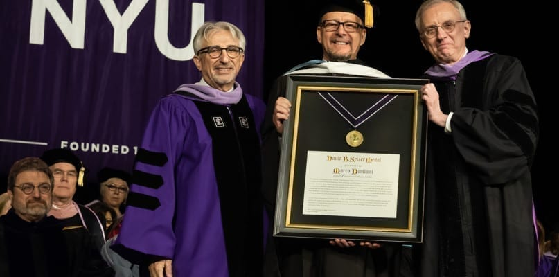 Marco Damiani accepts the Kriser Medal from the NYU College of Dentistry