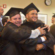 KCC Riggio program graduates Aristides Georgakopoulos and Jonathan Colon