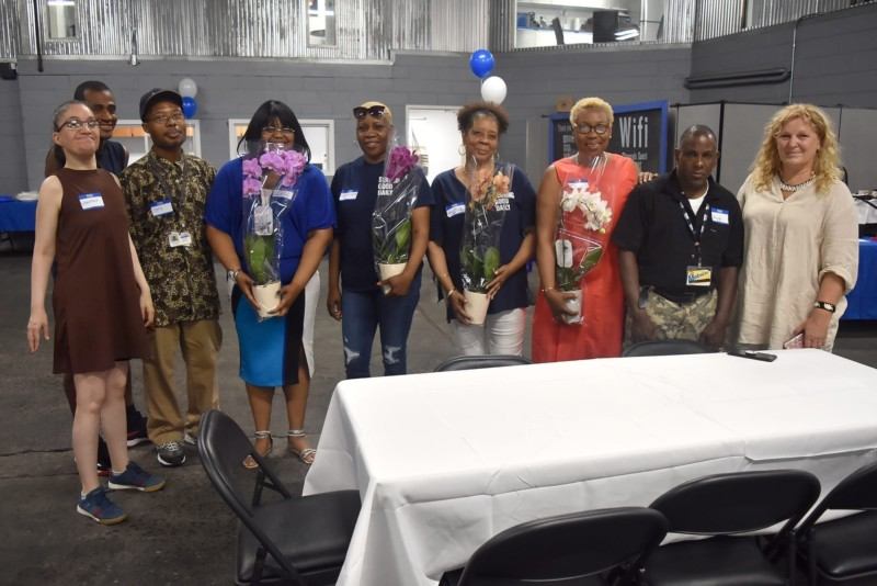 AHRC NYC volunteers gave their own thanks to CityMeals staff for the luncheon by gifting them beautiful orchids.