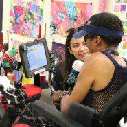 Alexandria Ocasio Cortez with artist Luis Clemente