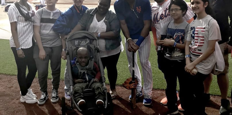 Amed Rosario, shorstop for the New York Mets, with people from AHRC NYC's Children's Services.