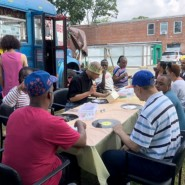 Project participants gathered for the final day of working together outside Far Rockaway Day Center