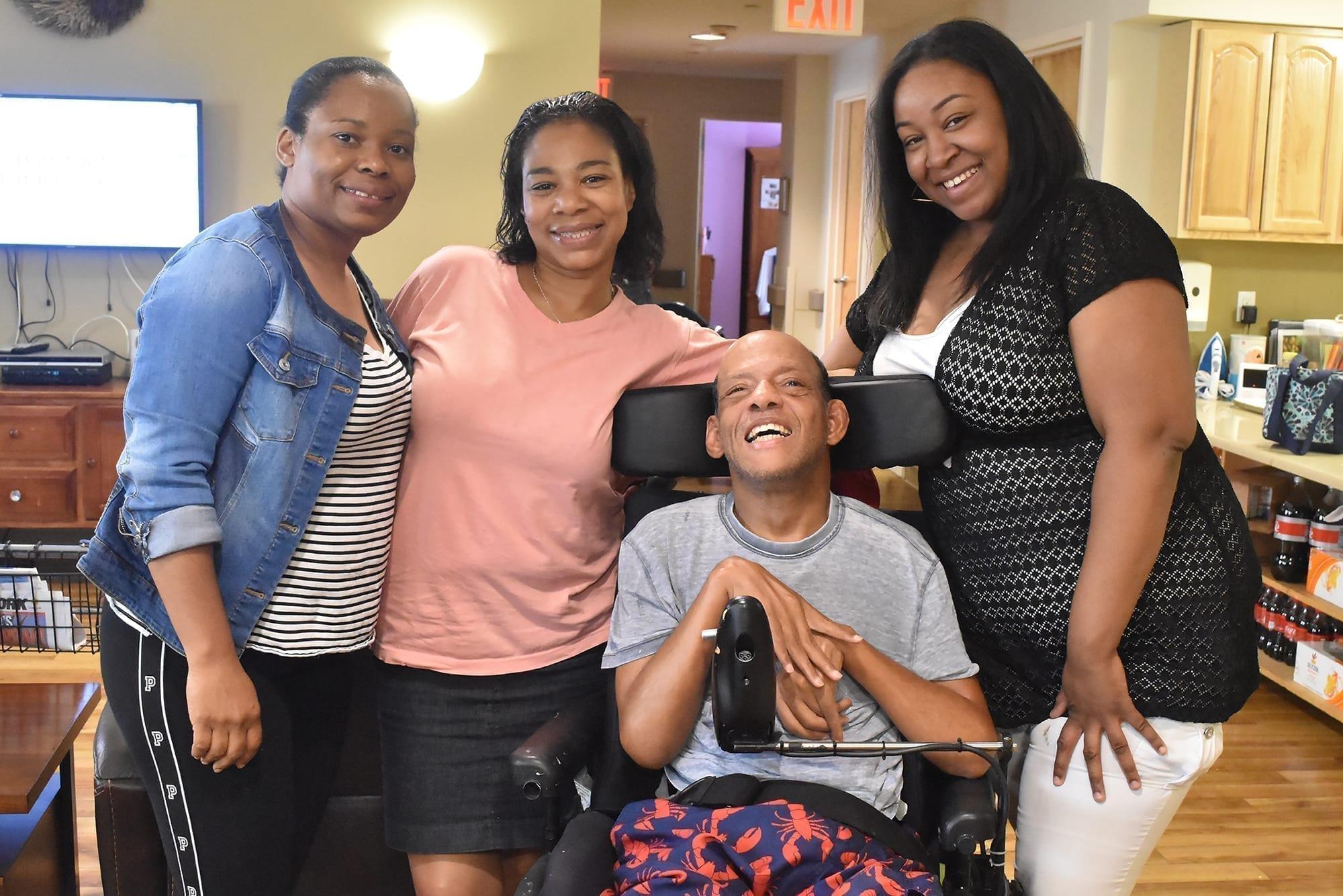 Juanita Yearwood, Nichole Tucker, and Tulina Simms with Bloomberg resident Claude Prophete