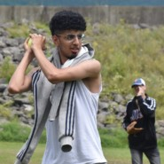 Naeem Saleh demonstrates to guests at The Lodge how to improve their softball batting stances