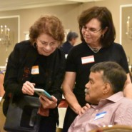 Margaret Puddington interacts with Dr. Carole Gothelf, Associate Vice President for Individualized Supports, and self advocate Bernard Carabello