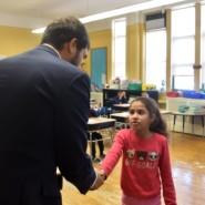 Student, Giana, greets Senator Andrew Gounardes during his visit to Brooklyn Blue Feather
