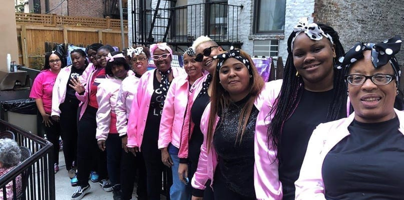 We Go Together! Fineson Residence staff members coordinated their pink outfits for the Grease themed party.