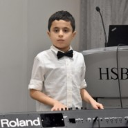 pianist Peter Maiorana from Brooklyn Blue Feather Elementary School performed at the HSBC event