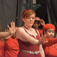 Cheryl Nelson, CSP, leads the performers in a holiday themed dance.