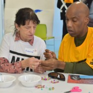 Rosalind, a volunteer with New York Cares, worked with Willie Boyd to create crafts that were to be donated to needy New Yorkers.