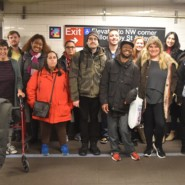 Self advocates and staff members from AHRC NYC with MTA representatives in the accessible station lab at Jay Street in Brooklyn.