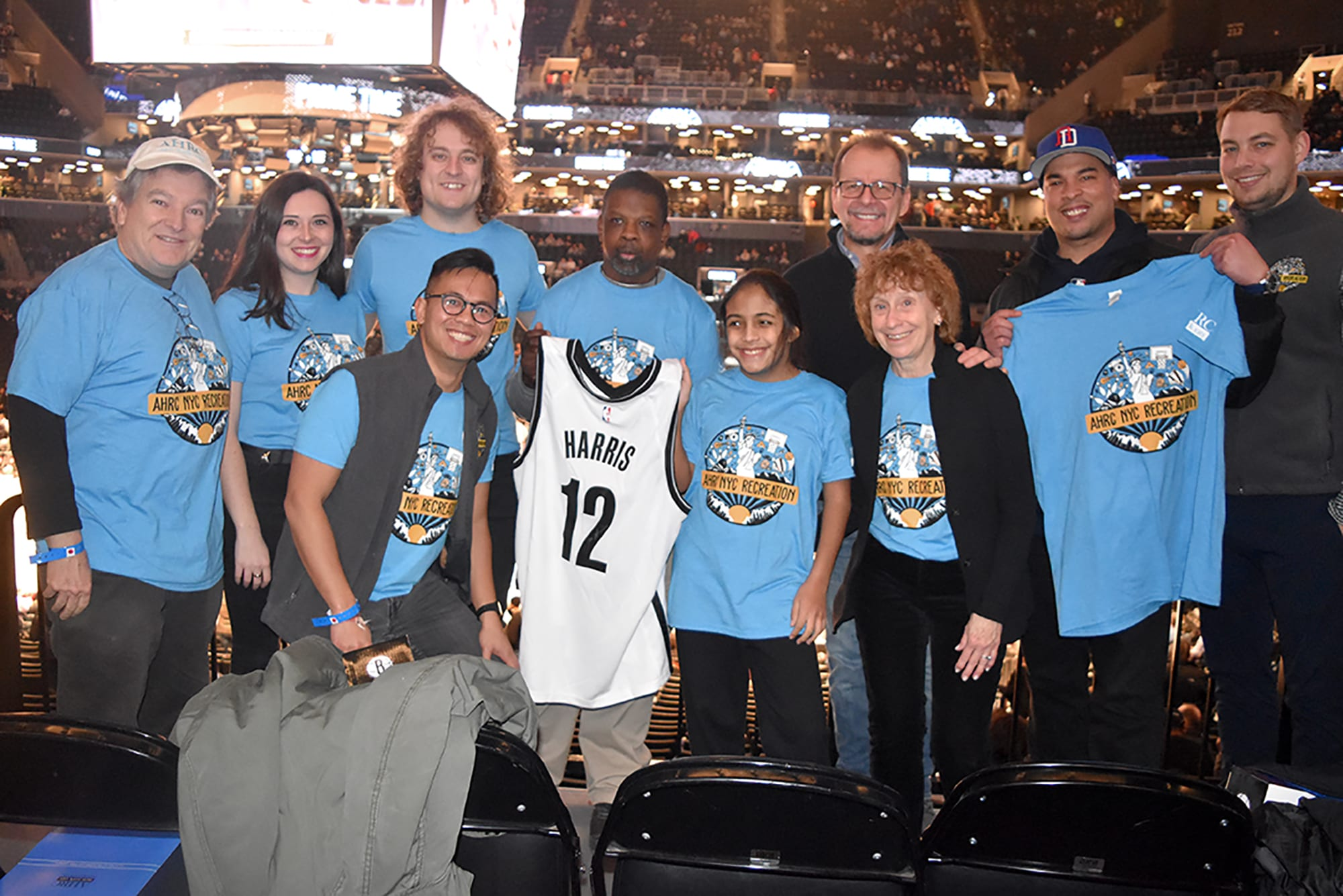 AHRC NYC leadership, Camping and Recreation staff members, and people supported before the January 31 Nets game.