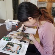 Yumi Miyake cuts out a picture from a magazine during a crafts lesson.