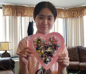 Yumi Miyaki with a homemade heart.