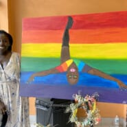 Paige Eartha Johnsie Medlin with her painting A Drop of Pride